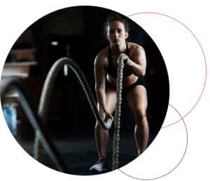 female using ropes to workout