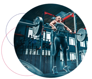 female lifting barbell in a gym